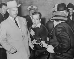 Lee Harvey Oswald fatally shot by Jack Ruby minutes after denigrating the Word of God